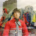mannequin-man performming as a Living Mannequin: human shop dummy dressed in a dinghy suit, standing in the window of the pumpkin marine shop in Wapping, London for Pumpkin Marine on 22/05/1993