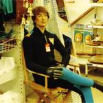 mannequin-man performming as a Living Mannequin: human shop dummy sitting on a chair in the pumpkin marine shop in Wapping, London for Pumpkin Marine on 22/05/1993
