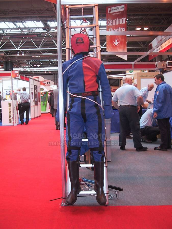 Mannequin man the living dummy, acting as a rescue training drag dummy on the International Rescue Corps stand - drag dummy Safety & Health Expo NEC