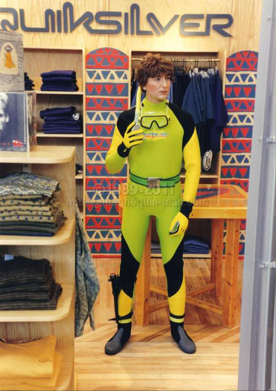 mannequin man dressed in a wetsuit pretending to be a shop display dummy in The Lillywhites Sports Store in London