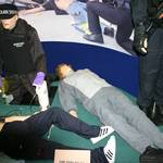 mannequin-man performming as a CPR Dummy: mannequin man as a living training dummy on hyperbaric medicine stand amongst other training manikins for Hyperbaric Medicine on 26/11/2009