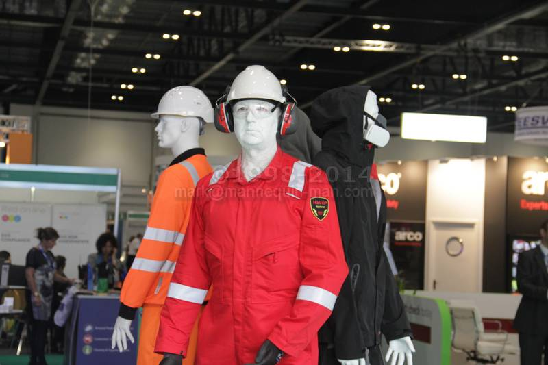 Standing with other mannequins on Greenham stand wearing HaVeP Explorer Anti Static Flame Retardant Coverall - Living mannequin with real mannequins on Bunzl Greenham stand at Health And Safety Expo 2014