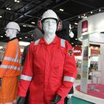 mannequin-man performming as a Living and Real Mannequin: Standing with other mannequins on Greenham stand wearing HaVeP Explorer Anti Static Flame Retardant Coverall for Bunzl Greenham on 17/06/2014