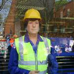 Mannequin Man dressed in PPE safety clothing standing in the window of the Machine Mart store in Docklands at the London Marathon 2011