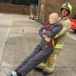 "As a more realistic an alternative to the ""Rescue Randy"" or ""Tuff Kelly"" manikins, mannequin man shown here being used as a 90kgs rescue dummy in the dummy drag, one of the events in the Fire Fighter Challenge"
