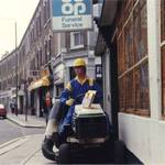 mannequin-man performming as a Living Mannequin: Mannequin man the living mannequin sitting on a Bolens lawn mower outside Greenwich HSS Hire Shop for HSS on 19/06/1993