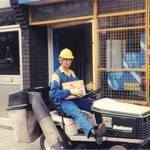 mannequin-man performming as a Living Mannequin: Mannequin man living mannequin performer sitting on a Bolens lawn mower outside Greenwich HSS Hire Shop for HSS on 19/06/1993