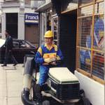 mannequin-man performming as a Living Mannequin: Mannequin man the living mannequin performer sitting on a Bolens lawn mower outside Greenwich HSS Hire Shop for HSS on 19/06/1993