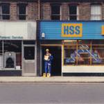 mannequin-man performming as a Living Mannequin: Mannequin man the living mannequin performer holding catalogues outside HSS Hire Shop Greenwich for HSS on 19/06/1993