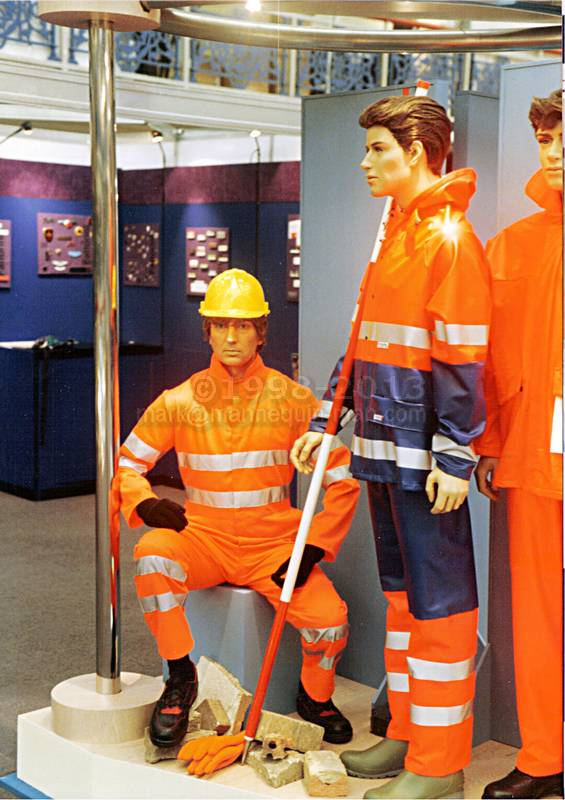 Human living mannequin in display with actual mannequins on Faithful stand at Career and Workwear show. Living Mannequin Career & Workwear Show