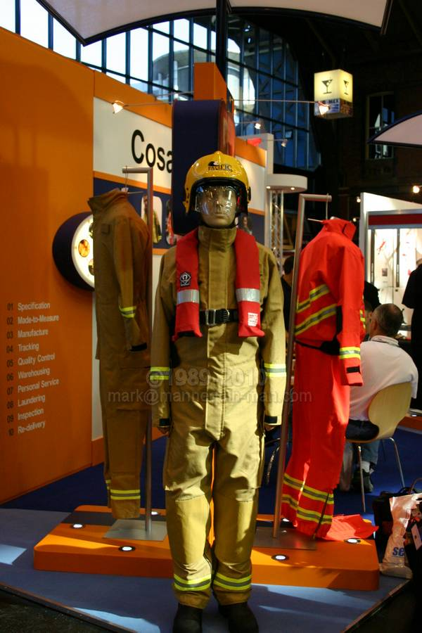 mannequin man standing on Cosalt Ballycare stand at Fire 2004 dressed in a Frontier fire coverall,secifically designed for use in wildland fire situations, this lightweight one-piece coverall aims to reduce the risk of heat exhaustion due to physical exertion over long distances - Living Mannequin Fire 2004 NEC