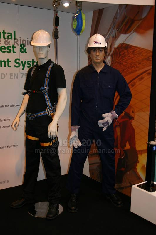 dummy in fall arrest harness on Metreel stand - Living Mannequin Safety & Health Expo NEC