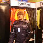 mannequin-man performming as a Living Mannequin: mannequin man standing on ocean rainwear stand wearing a hi-vis grey waterproof coverall at the safety & health expo 2005 for Ocean Rainwear on 18/05/2005
