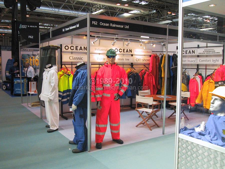 mannequin man standing on ocean rainwear stand wearing a hi-vis red waterproof coverall at the safety & health expo 2002 - Living Mannequin Safety & Health Expo NEC
