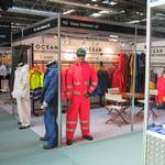 mannequin man standing on ocean rainwear stand wearing a hi-vis red waterproof coverall at the safety & health expo 2002