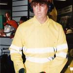 mannequin-man performming as a Living Mannequin: mannequin on centre display wearing yellow hi-vis overall and hard hat for Arco on 23/12/1994