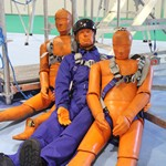 mannequin-man performming as a CPR Dummy: Mannequin man with the orange test dummies used in IKAR GB fall arrest demonstrations at Safety & Health Expo London ExCeL 2016 for IKARGB on 23/06/2016