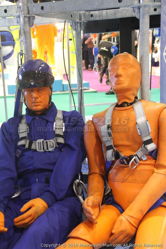 Mannequin man with the orange test dummies used in IKAR GB fall arrest demonstrations at Safety & Health Expo London ExCeL 2016. Orange Fall Arrest Test Dummies Ikargb Safety Health Expo