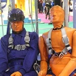 Mannequin man with the orange test dummies used in IKAR GB fall arrest demonstrations at Safety & Health Expo London ExCeL 2016