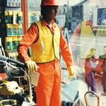 Mannequin man working as a living shop window display dummy mannequin for SBN tool hire in 1990
