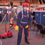mannequin-man performming as a Living Mannequin: mannequin man on the protecta international stand demoing a fall arrest harness for Protecta International on 19/05/2003