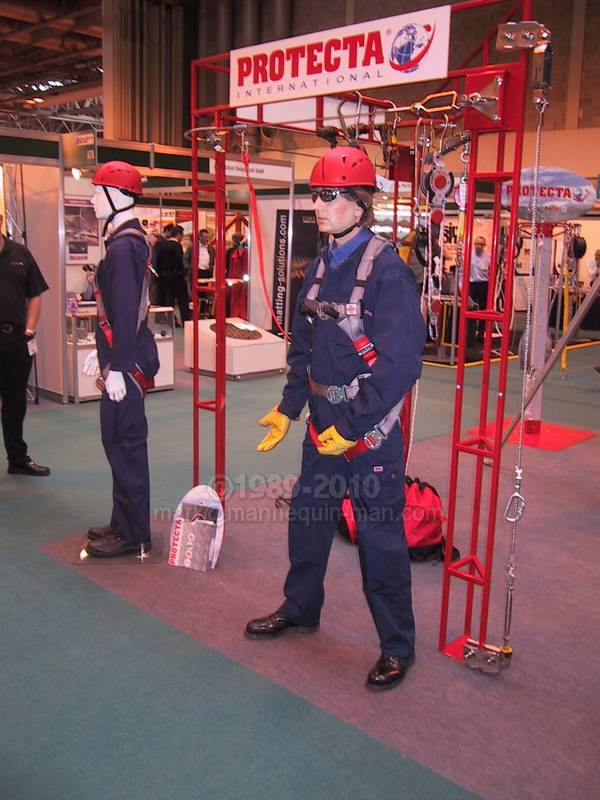 mannequin man on the protecta international stand demoing a fall arrest harness - Living Mannequin Safety & Health Expo NEC