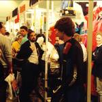 mannequin-man performming as a Living Mannequin: mannequin man smiling at young boy at Earls Court Boat Showwearing Diamond wetsuit for Pumpkin Marine on 11/01/1992