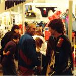 mannequin-man performming as a Living Mannequin: mannequin being examined by customers at Earls Court Boat Show for Pumpkin Marine on 11/01/1992