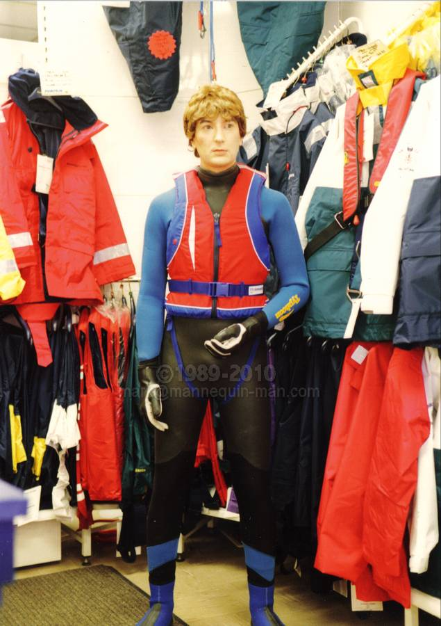 human shop dummy dressed in a wetsuit, standing in the pumpkin marine shop in Wapping, London - human shop dummy pumpkin marine