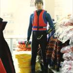 mannequin-man performming as a Living Mannequin: human shop dummy dressed in a wetsuit and life jacket, standing in the pumpkin marine shop in Wapping, London for Pumpkin Marine on 22/05/1993