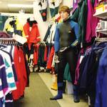 mannequin-man performming as a Living Mannequin: human shop dummy dressed in a wetsuit, standing in the pumpkin marine shop in Wapping, London for Pumpkin Marine on 22/05/1993
