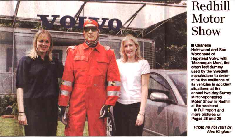 Charlene Holmwood and Sue Woodhead of Hampstead Volvo with 'Mannequin man', the crash test dummy, used by the Swedish manufacturer to determine the resilience of its vehicles in accident situations, at the annual two-day Surrey Mirror-sponsored Motor Show in Redhill at the weekend.