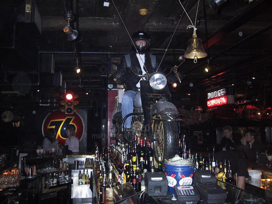 living statue riding a motorbike suspended in the air at the Road House restaurant in Covent Garden - Living Mannequin Road House Mannequn Covent Garden, London