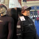 mannequin-man performming as a Living Mannequin: Mannequin man wearing a Magic Marine Regatta Drysuit standing with other mannequins on the LDC Sailing Parts & Clothing stand at the RYA Dinghy Show Alexandra Palace 2013 for LDC Sailing Parts & Clothing on 02/03/2013