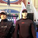 mannequin-man performming as a Living Mannequin: Mannequin man wearing a Magic Marine Regatta Drysuit standing with another mannequin on the LDC Sailing Parts & Clothing stand at the RYA Dinghy Show Alexandra Palace 2013 for LDC Sailing Parts & Clothing on 02/03/2013