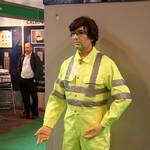 mannequin-man performming as a Living Mannequin: performing as a human show dummy on the stand of Praybourne Limited wearing a yellow pulsar teflon coated coverall for Praybourne on 13/05/2008