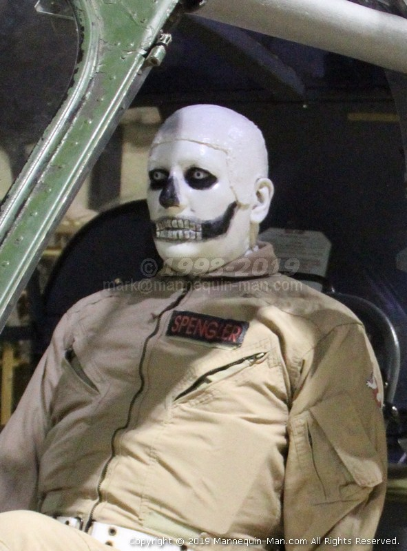 Mannequin man at the Army Flying Museum surprising the visitors as a scary skeleton ghostbuster helicopter pilot mannequin during their Halloween event - Scary Skeleton Mannequin Surprising Visitors at the Army Flying Museum Halloween Event