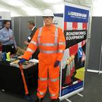 mannequin-man performming as a Living Mannequin: Living safety mannequin on the Bunzl Greenham stand amusing the visitors to the SEHAUC Streetworks exhibition at Kent Showground 2014 for Bunzl Greenham on 17/09/2014
