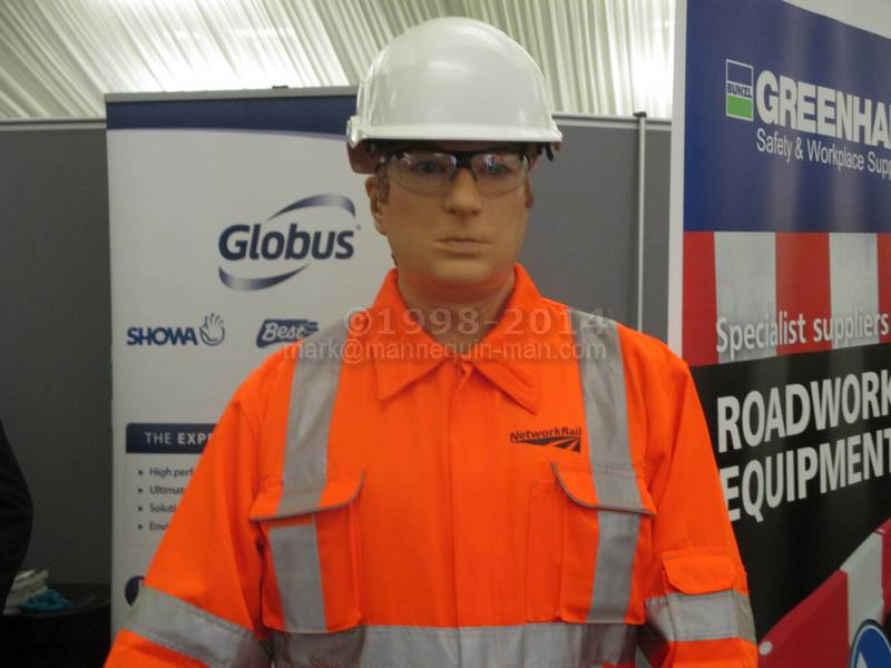 Living safety mannequin on the Bunzl Greenham stand amusing the visitors to the SEHAUC Streetworks exhibition at Kent Showground 2014 - SEHAUC Streetworks mannequin Bunzl Greenham stand