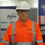 Living safety mannequin on the Bunzl Greenham stand amusing the visitors to the SEHAUC Streetworks exhibition at Kent Showground 2014