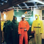 mannequin-man performming as a Living and Real Mannequin: Wearing a High Visibility (Hi-Vis) Orange Chemsol Plus Chemical protective clothing coverall suit and white hard hat standing with two real mannequins dressed in PPE for Alpha Solway on 17/09/1998