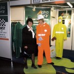 mannequin-man performming as a Living and Real Mannequin: Wearing a High Visibility (Hi-Vis) Orange Chemsol Plus Chemical protective clothing coverall suit and white hard hat shaking hands with a customer for Alpha Solway on 17/09/1998