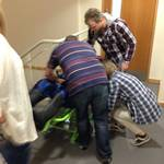 Exercise to move 90kgs Dummy Training Mannequin using a Stairway Evacuation Chair during FMC Safety Day