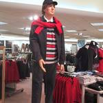 Mannequin man posing as a male clothing display dummy in Croydon's Marks & Spencer department store.