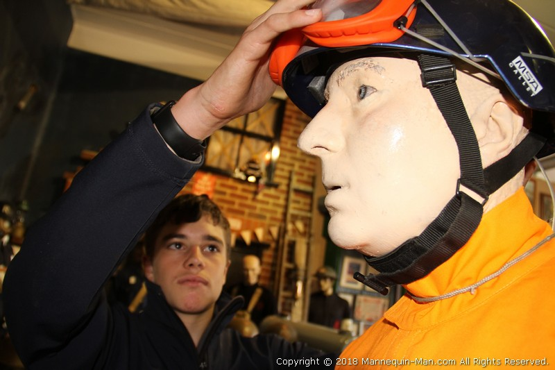 Exhibit showing Coverall used by USAR Search and Rescue teams at the Essex Fire Museum - USAR Coverall Search and Rescue mannequin at the Essex Fire Museum