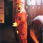 mannequin-man performming as a Living Mannequin: mannequin man set up in display area ouside seminar for UVEX's new workwear clothing launch in Durham, wearing red and grey UVEX overall and red hard hat for Uvex on 21/03/1996