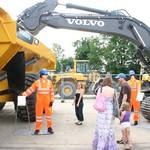 mannequin-man performming as a Living and Real Mannequin: Living Mannequin man standing by an A40F digger scaring employees and family members at the Volvo employee family day at the office in Duxford for Volvo Trucks on 03/07/2011