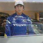 Mannequin-man posing as a racing driver in a Volvo racing suit in car showroom in Croydon at a Volvo used Car Event