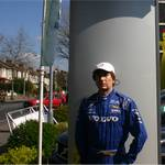 mannequin-man performming as a Living Mannequin: human mannequin mannequin-man in dressed in Volvo racing suit in outside car showroom in Croydon for Hapstead Volvo on 09/04/2005